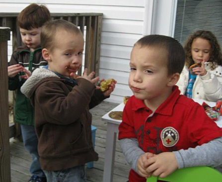 Evan and his cousins celebrating with (in?) chocolate.