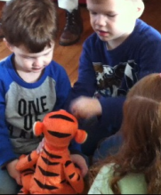 Even and his brother Conner playing with Tigger.