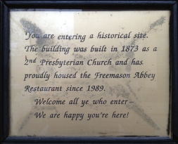 Informational plaque at the Freemason Abbey.