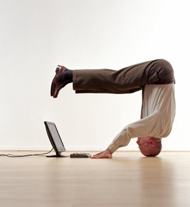 When you start blogging, you may feel like you have to stand on your head to get the software to do what you want.  (Photo from eblingroup.com)