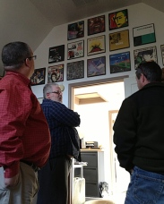 ...visiting the books and the album covers that Rob recently hung.