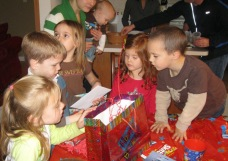 The boys in this photo are all my nephews (Connor to the left, Tommy in Lucy's arms, and David peering into Connor's gift bag).