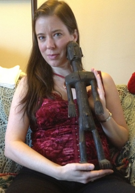 Heather with wood carving. (Several years ago, Heather and Leslie were cultural envoys to Zimbabwe.)