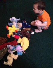 David and I play hide and seek using his stuffed animals.