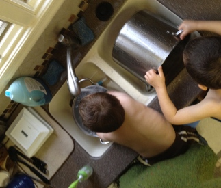 Washing dishes with Chris and David is a full-contact sport.