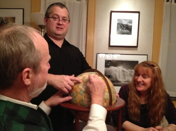 Dave, Glen, and Jamie, clarifying our position on the globe. (Notice Glen's photos of Mayo, Ireland on the wall behind.)