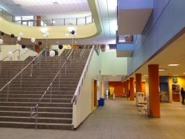 ...with its grande central stair wrapped by a third-floor track for running.