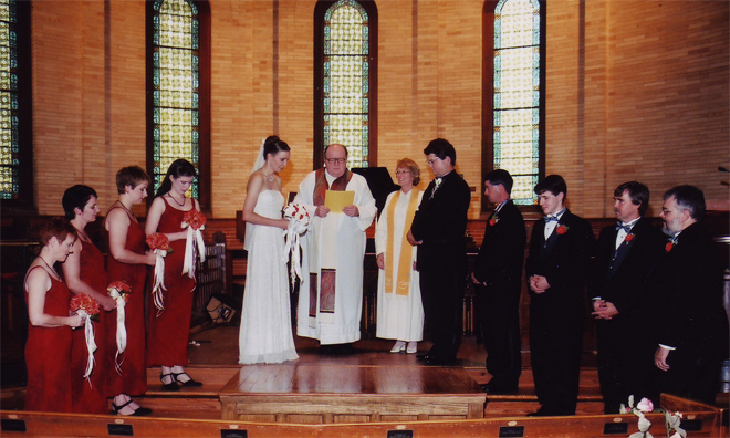 Our 2001 wedding ceremony at Hampton University Memorial Church with (left to right) Annie Nichols, Esther Sterchi, Katie Sullivan Booth, Heather Massie, Shannon Chance, Fr. Slovik, my mom Rev. Dr. Cynthia Massie,  Mara, Dave Chance, Jay Gallagher, Michael, Chance, John Baird, and Rob Nichols.