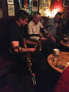 Jonathan Kennedy playing uilleann pipes with an Irish man he has played pipes with the States.