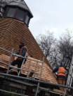 "Workers re-shingling the roof of a garden pavilion. They said ""hi!"""