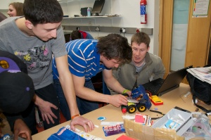 Dave Dorran working with students at the mid-semester trials for RoboSumo, March 2012. (Photo by Shannon Chance.)