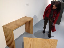 Pam studies a table on display at NCAD.