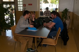 Here, students work in the cafeteria.