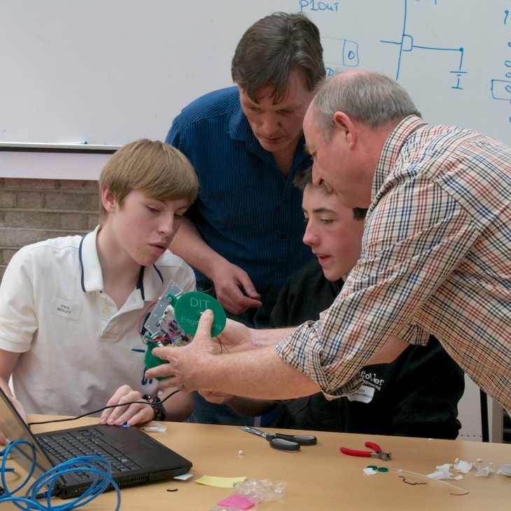 Engineering lecturers Frank Duignan and Mick Core explaining concepts to two Transition Year students at our May RoboSlam.