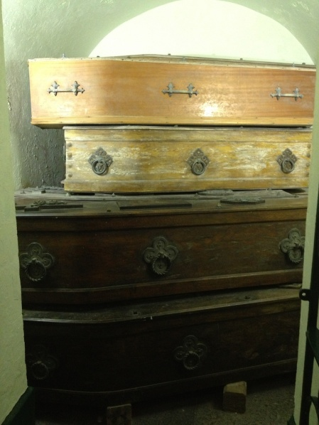 In times of disease, they sealed coffins like these carefully to keep illness from spreading.