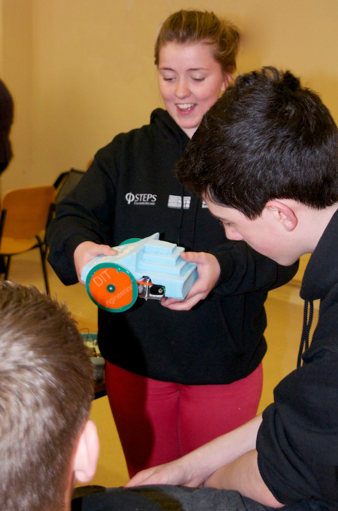 Transition Year students discussing their final, fully functioning robots.