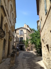 A small little plaza along a street in Uzes.