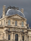 Teh Louvre, with a dramatic sky.
