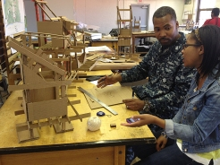 "Cedric and Sheldyn are working on a cluster of cabins for ""Camp Nebula."""