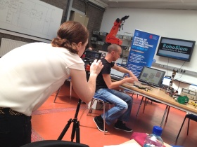 RTE's Sinead Morris filming DIT's Ted Burke using a kitted-out iPhone 5.