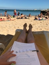 Evaluating journal manuscripts is quite enjoyable under a beach umbrella.
