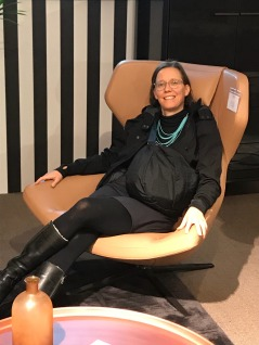 Shannon in lounge chair at Harrods